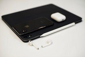 black iPhone x on black iPad